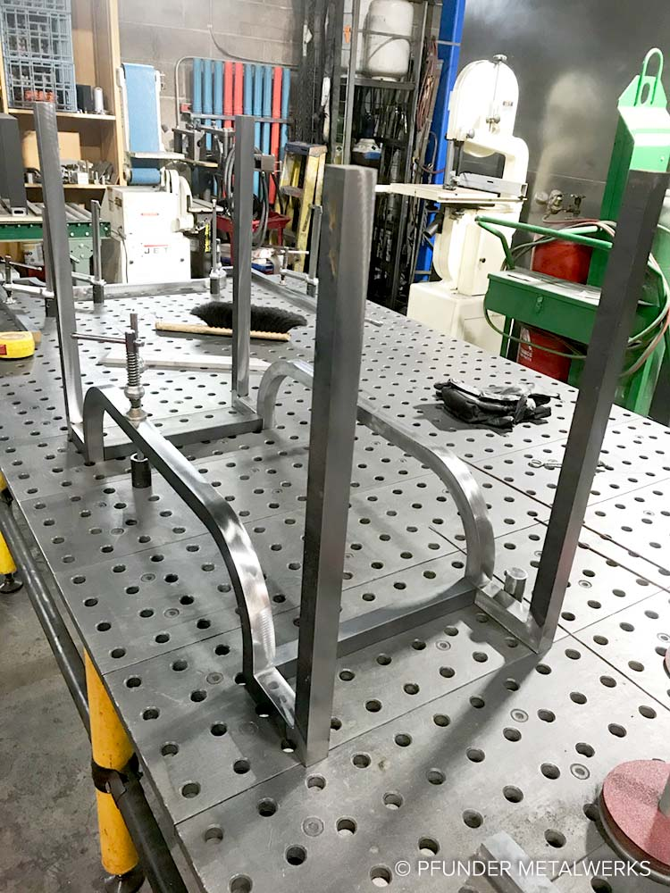Curved steel bench legs, in progress