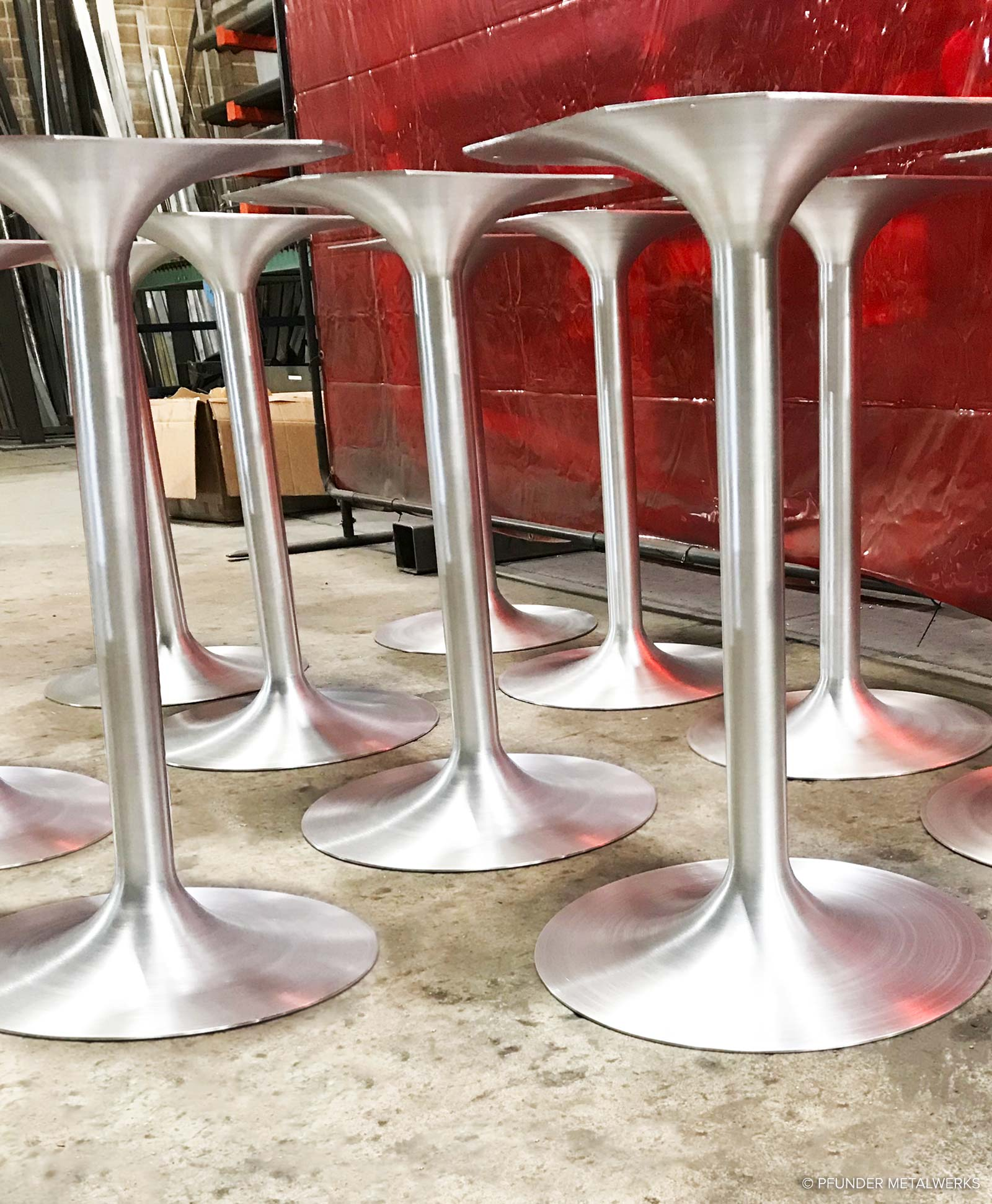 Tulip side table bases in brushed aluminum