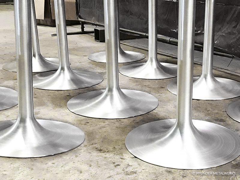 Brushed aluminum tulip table bases